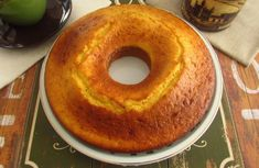 A quick and simple cake to prepare, a tasty orange and milk cake, ideal to serve with tea in a family snack.