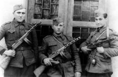 Montenegrin communistpartisans of the 2nd Company, 3rd Battalion, 4th Proletarian Brigade of the People's Liberation Army of Yugoslavia, Života Milosavljević (left), Života Trenkić (center)and Jugoslav Miljković (right)pose for a photograph armed with Soviet-produced ShpaginaPCA-41submachine guns. The National Liberation Army and Partisan Detachments of Yugoslavia, led by Josef Broz Tito, fought against Axis forces, as well as Yugoslavian factions such as the Serb nationalist and…