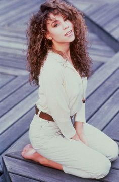 Call me crazy, but I prefer this 1993 Mariah much more than 2014.  This pic was before spray tans, ghetto talk and blondifying. This was the NY, half white/half black girl with the curly hair who could sing like nothing we've ever heard before!! This was my favorite Mariah!