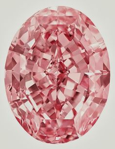 Absolutely stunning.  The Pink Star, 59.60ct FVP IF Oval.  Different article says the gem was found in a De Beers mine in 1999 (location unknown), cut from 132.5ct of rough and took two years to cut. The stone was sold in 2007 and is now back on the market.  Jewelry News Network: Sotheby's To Sell 'Most Valuable Diamond Ever to be Offered at Auction'