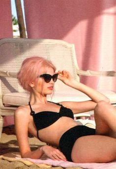 pink hair, black bikini, cat eye sunglasses. Perfect.