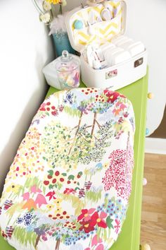 Pretty changing table set-up. I love the diaper suitcase and the fabric