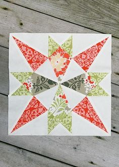Star of Mystery Quilt Block - This stunning example of paper piecing would be a great quilt block to repeat over and over again for a celestial quilt. Plus, you could easily use scraps to fill in the colorful portions of the block.
