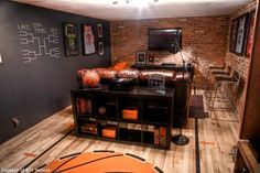 Man cave... love the chalk board wall for brackets and score keeping