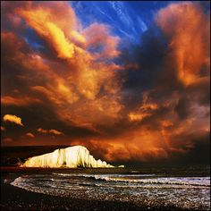 Moods of Nature - Photographer says - This is Englands famous Seven Sisters on the Sussex coast, it's all to do with mood and atmosphere and of course that fabulous sky with a hint of a rainbow!