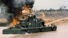 Vietnam War - USN  'Zippo' flame-throwing monitor uses fire to destroy enemy hiding places ashore.