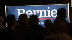 Supporters of Democratic presidential candidate Senator Bernie Sanders (I-VT) rally near Sheslow Auditorium on the campus of Drake University prior to the start of the Democratic presidential debate on November 14, 2015 in Des Moines, Iowa.