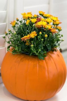 Pin for Later: Get Floral For Fall With This DIY Pumpkin Flowerpot