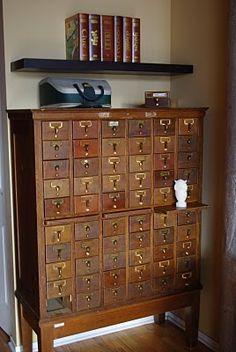 Card catalogue. I've wanted one of these, my whole life. I want it as a little shrine to the blessed goodness that is the Dewey Decimal System. I can smell all of those little manila cards, just looking at the photograph. Remember the wonder of looking through these, as a child? The entire world of books, finger by finger, all neatly organized in 3x5.