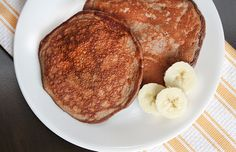 Whip up a healthier pancakes at home! This protein-packed chocolate-banana pancake recipe is dairy and gluten-free, and under 300 calories per serving!