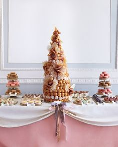 Decadent French Desserts: Instead of a cake, a French croquembouche was served at this city-chic wedding. Madeleines, tiny eclairs, and macarons gathered from a handful of French patisseries in New York City flanked the croquembouche. Croquembouche, Desserts Français, French Desserts, Wedding Desserts, Macaroons Wedding, Buffet Dessert, Dessert Bars, Dessert Tables, French Wedding Cakes