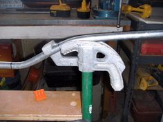 Conduit placement for the second bend of an offset. Marks were placed on the arrow. This bend is complete with the conduit matching the 22 degree mark on the bender.