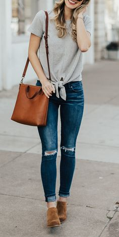 T-shirt with tie front, skinny cuffed jeans, brown leather purse