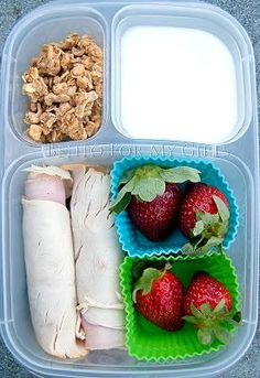 Quick and simple lunch box. There are 2 ham and turkey roll ups, strawberries, #homemade yogurt and Kashi granola. #Easylunchboxes