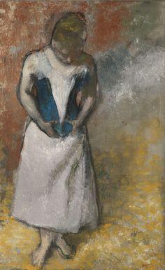 Femme debout et vue de face agrafant son corset (ca. 1883) - Edgar Degas