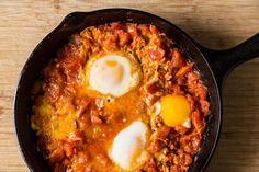 Tomato-y, Yogurt-y Shakshuka. Olive oil, harissa, tomato paste, red peppers, garlic, cumin, crushed tomatoes, eggs, greek yogurt