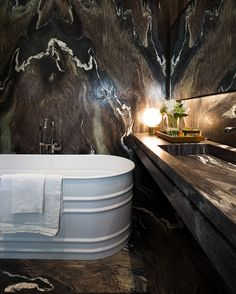 I really wanted a strong, masculine bath, and the stone was important to set this tone.