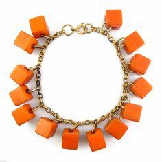 "fun vintage 1930s handmade Art Deco geometric design butterscotch Bakelite cube dangles on brass chain bracelet - measures 7-1/4"" long, the dangles measure 3/8"" at each face, 14 dangles total."
