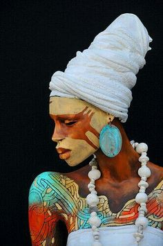 All he headdresses are variation, contrast, and harmony - this one also like and color