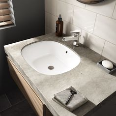 Concrete countertops complement the TOTO Lavatory in this modern bathroom design.