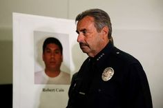 Los Angeles Police Chief Charlie Beck walks past a display board showing an image of officer Robert Cain after a news conference Thursday, June 22, 2017, in Los Angeles. Cain has been arrested for allegedly having sex with a 15-year-old cadet who's suspected of joyriding in stolen patrol cars. (AP Photo/Jae C. Hong)