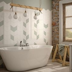 This gorgeous bathroom project features our Dewdrop tile in mint green and white - the colours compliment the exposed wood and brick perfectly. #bathroom #interiors #residentialdesign