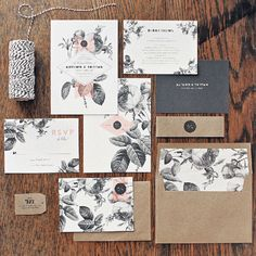 Vintage botanical etchings get a modern update with a black-and-white color palette with pops of peach. Kraft envelopes add a rustic touch./