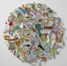 Map art by Chris Kenny , he creates pieces made from cutting maps and rearranging them into unusual collages. via