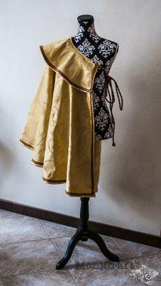 Brocade mantel. Cappa in damascato