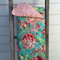 Image of Aqua floral cot quilt with pink/gold dots