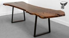 UHURU TRAPPED BASE TABLE // Shown in locally milled claro walnut slab and blackened steel base, 42x90x29.5H, 2006 // DESCRIPTION: The Trapped Base Slab Dining Table is created from a one-of-a-kind hardwood slab set on trapezoid shaped steel legs. Can be made from 2″ x 1″ or 3″ x 3″ tubing with a blackened or powder coated finish.  Our large wood slabs are locally milled and dried and come from sustainably harvested trees. Like diamonds, no two slabs are the same. // uhururdesign.com