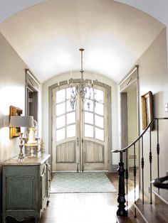 Arched Double Front Doors Design, stairs to side and not main focus, barrel ceiling