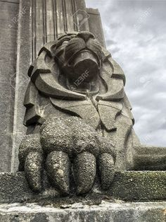 A Large Concrete Lion With Huge Claws Guards The Entrance To.. Stock Photo, Picture And Royalty Free Image. Image 59340027.