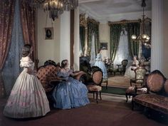 $99.99 - Women in Period Costumes Sit in an Antebellum Mansion's Drawing Room Photographic Poster Print by Willard Culver, 30x40  Women in Period Costumes Sit in an Antebellum Mansion's Drawing Room is digitally printed on archival photographic paper resulting in vivid, pure color and exceptional detail that is suitable for any museum or gallery display. Finding that perfect piece to match your interest and style is easy and within your budget...