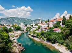 Mostar Mostar, Bosnia and Herzegovina outdoor tree mountain sky water mountainous landforms geographical feature Town landform River mountain range vacation tourism Nature aerial photography Village flower landscape rural area alps cityscape Sea traveling surrounded hillside