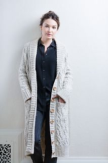 Wonderfully warm on winter mornings as it may be, this knee-length knitted robe in Shelter is too beautiful to confine to the house. A symphony of extravagant cables demands public appreciation. On top of its ornate motifs, Aspen boasts a full array of perfect details: a large shawl collar shaped with short rows, set-in sleeves, generous pockets, a ribbed belt and belt loops. Subtle A-line shaping allows for easy movement within a trim silhouette. This robe is a master class in cable…