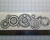 Doctor Whos Gallifreyan Name Black Vinyl Decal (11.25 in x 3.674 in)