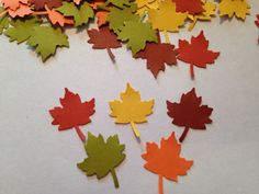 You are looking at 100 fall leaves. They are made of card stock. Each leaf measures approximately 7/8 x 1 inch. These are made using a hand