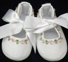 Precious baby shoes make a great keepsake gift. These have satin ribbons for ties and a darling embroidered flower pattern.
