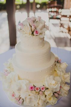Three tiered white wedding cake with roses | Wild Whim Design & Photography