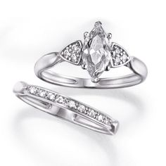 1-carat center CZ in a CZ-embellished sterling silver setting comes with a matching wedding band.Sizes: 6-10