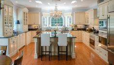 Sandstone Kitchen   Crystal Cabinets.  IDEA FOR WINDOW OVER SINK.