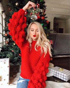 """is wearing the """"Clora' Pom Pom Sweater. The sleeves make it so fun!"""