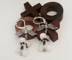 Paw Print  Angel Wing Earrings: white dog bone beaded earrings with paw prints…