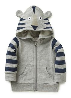 100% Cotton Hoodie. Brushed french terry with zip through front. Features graphic tiger print on hood with ears, and printed stripe on sleeve. 1x1 Rib cuff, and hem with contrast flatlock finish. Available in Grey Marle.