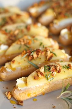 These Honey Crisp and Goat Cheese Ladyfinger Crostini Appetizer are the perfect holiday appetizer served with fresh rosemary on top, the herb of friendship.