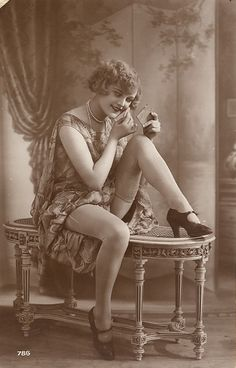"Flapper: The embodiment of everything a ""lady"" out not to be. A flapper smoked, drank, kissed in cars, and danced the night away."