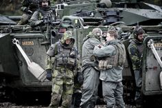 Swedish Pansarskyttar (anti-tank soldiers) taking an break during an exercise with two CV9040's in the background.