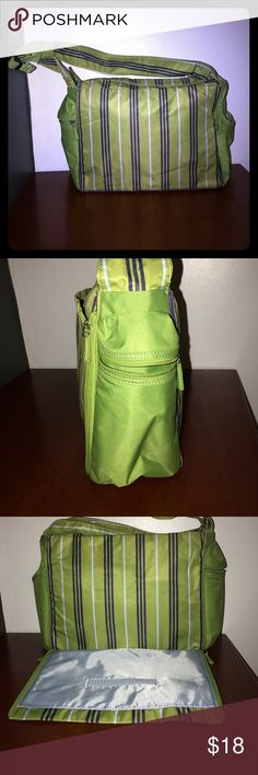 Vintage Tommy Hilfiger Green Diaper Bag In great condition. Never used. Love this Diaper Bag. Comfortable thigh strap. No flaws. Pet free smoke free home. No tears or stains. 15 inches long 10 inches tall two side compartments on the sides for bottle or water. Tommy Hilfiger Bags Baby Bags