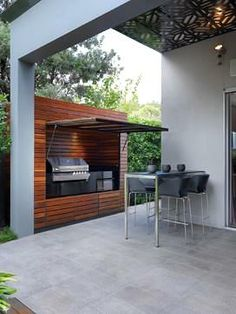 A custom-designed barbecue hutch - a great addition to your outdoor space if you don't like the idea of a barbecue being out in the open for all to see.